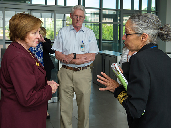 Capt. Monica Parise, MD, Director of the Division of Parasitic Disease and Malaria (DPDM) (right) ushers new CDC Director Dr. Brenda Fitzgerald (left) in to DPDM's laboratories for a tour with DPDM Entomology Branch Chief, Dr. Bill Hawley (center).