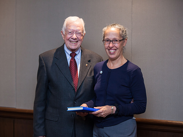 Capt. Monica Parise, MD, Director of the Division of Parasitic Disease and Malaria with former President Jimmy Carter at a meeting of the Onchocerciasis Elimination Program of the Americas in Mexico, November 2014. Photo credit: The Carter Center.