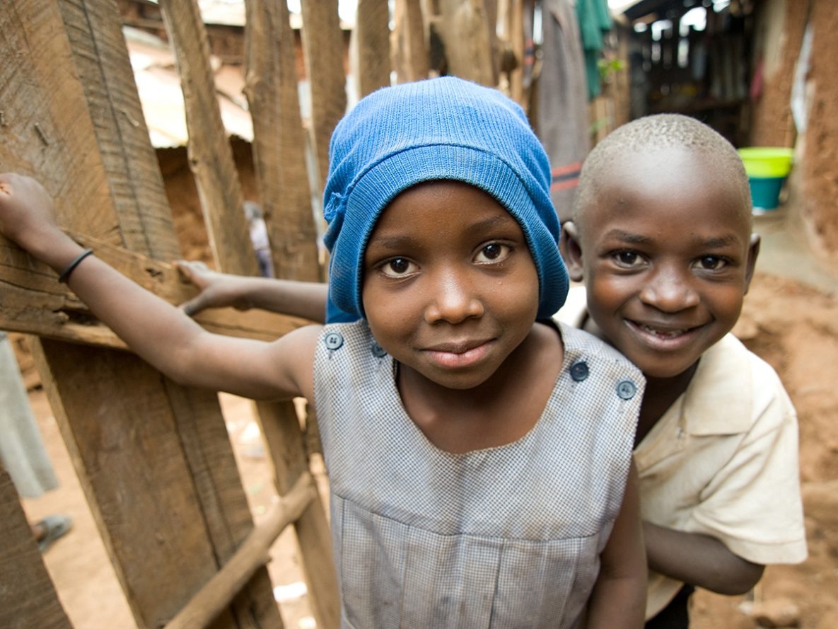 A young girl and boy outside of their family home in the Kibera informal settlement in Nairobi, Kenya.
