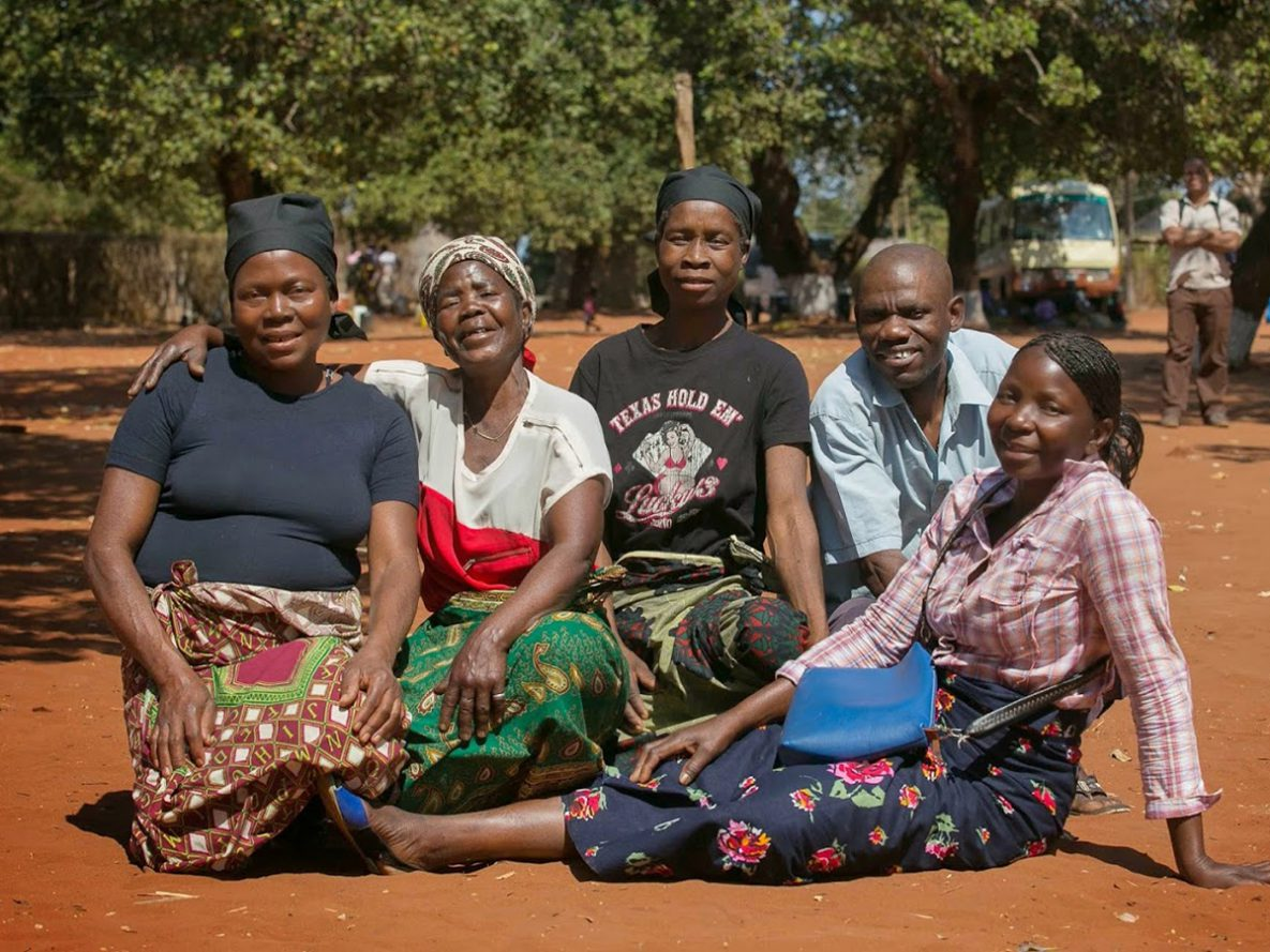 On a rotating basis, these members of a community support group in Mozambique collect and distribute HIV medications to each other, which helps them to maintain their treatment.