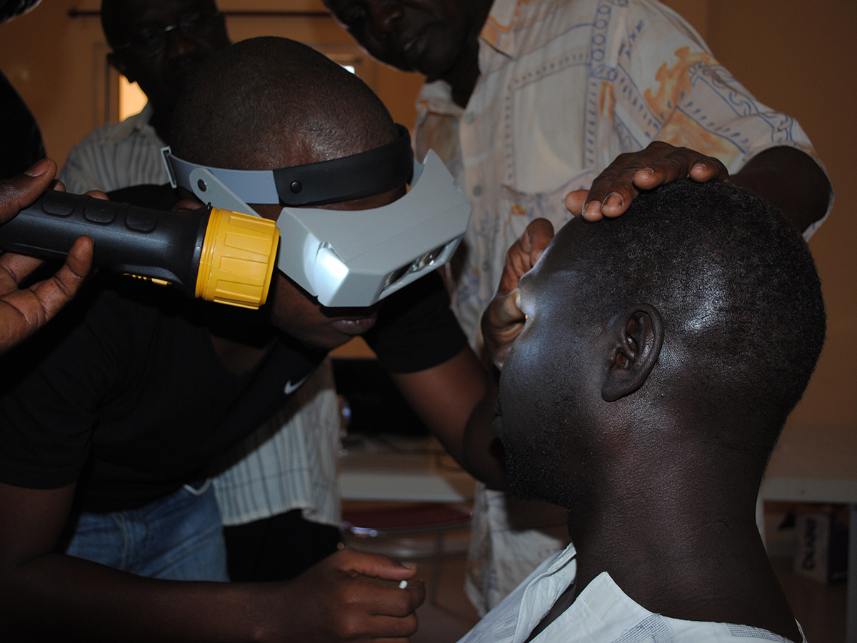 A community health worker conducts screening for trachoma in Senegal. DPDM has been working to develop laboratory tests for trachoma that do not require physical examination of the eye.