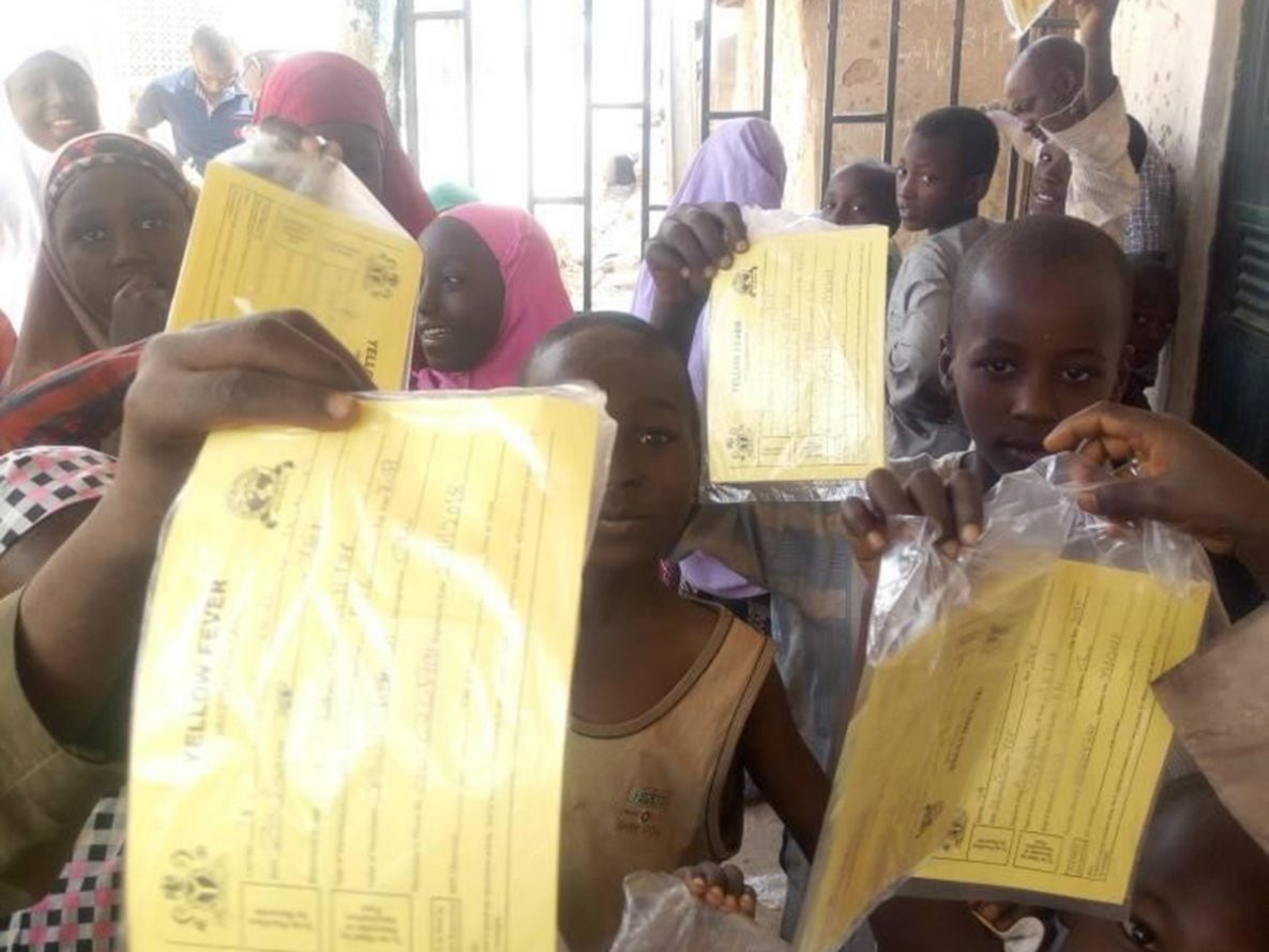 Children showing their yellow fever vaccination cards in Tsafe Central ward, Tsafe LGA after getting vaccinated. The transparent bags were introduced to encourage safe keeping of their cards