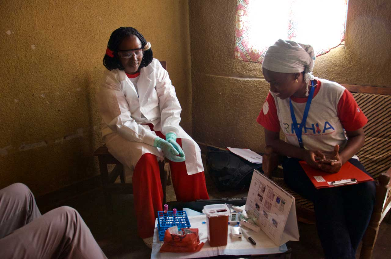 Community workers in a local citizen's home after collecting blood samples
