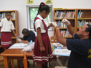 Public health worker collecting blood in American Samoa. Credit: CDC photo, Angela Keller