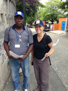 CDC's Dr. Alaine Knipes with a surveyor in  Petionville, Port-au-Prince, conducting the  house-to-house coverage survey using mobile data collection.