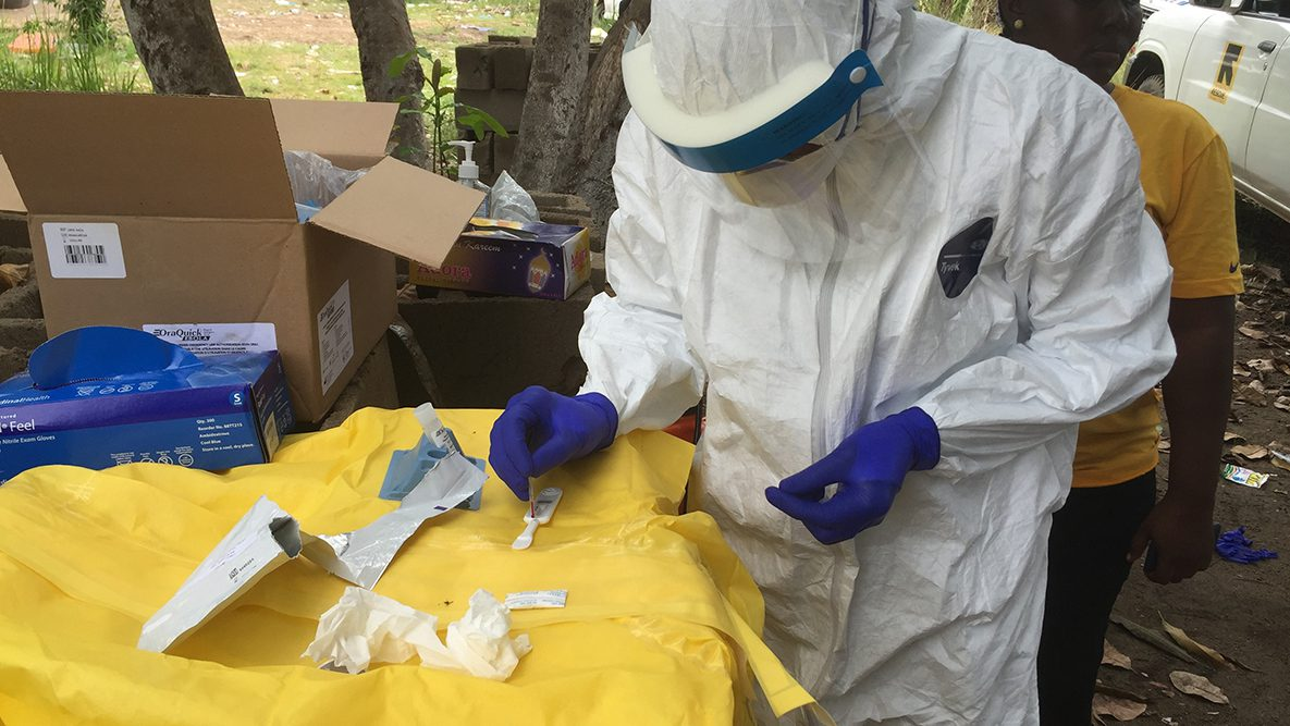 Disease detectives conducting testing out in the field during the 2014 Ebola outbreak in Liberia.