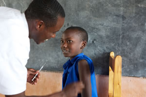 Vaccination of Rwandan boy