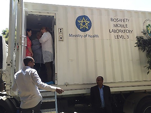Biosafety and biosecurity experts in Ethiopia prepare to assess a BSL-3 mobile laboratory to assist in preparing a biorisk plan for the facility.