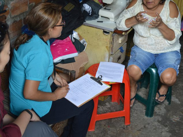 Study staff administering neurologic symptom screening questionnaire as part of Zika study in Iquitos, Peru.
