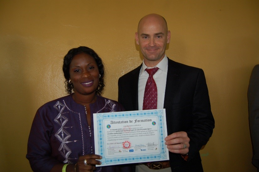 Dr. Dieynaba Kane at the FETP Frontline graduation ceremony with CDC Senegal Country Director, Dr. Michael Kinzer
