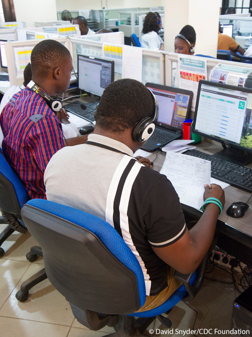 Freetown, Sierra Leone - The 7-1-1 section of the 1-1-7 call center at the AFCOM building in Freetown. The 7-1-1 number is used for Ebola vaccine trial participants, while the 1-1-7 number is the national Ebola hotline. The CDC Foundation provides support to both centers.