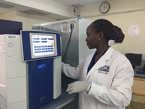 Researcher setting up a Taqman Array Card (TAC) to test for acute febrile illness on Somalia outbreak samples.