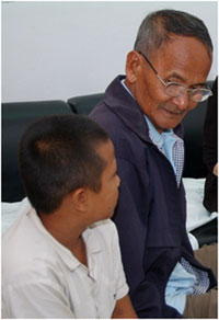 A grandfather and his HIV-infected grandson receive counseling at Bangkok's Siriraj Hospital, which uses a new model of pediatric HIV counseling.