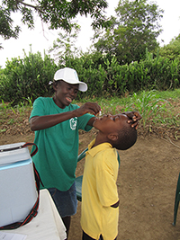 Boy receiving the oral cholera vaccine at a vaccination post.