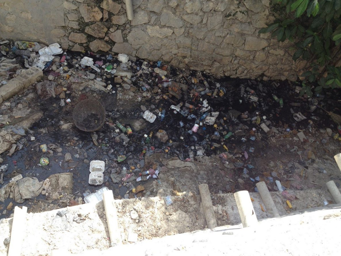 An example of poor fecal sludge management with septic tanks overflowing into drainage canals in the heart of Port-au-Prince, Haiti (Photo courtesy of Andrea Martinsen, CDC)