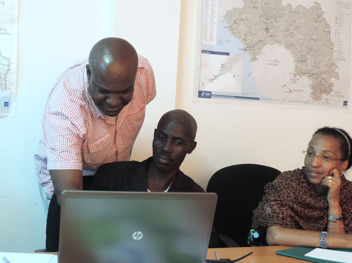 workers at the EOC in Guinea coordinate efforts to fight Ebola.