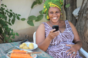 Tanzania Women on her phone