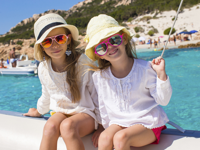 Two young girls wearing sunglasses