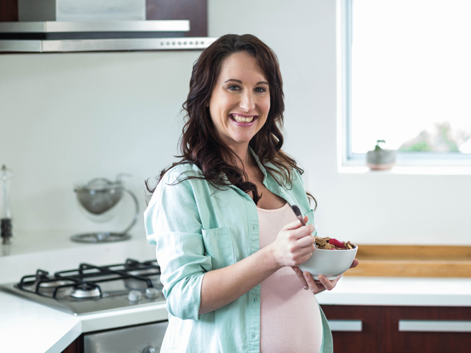 Pregnant women eating cereal