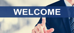 Businessman hand touching WELCOME sign on virtual screen