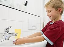 Photo of child washing hands