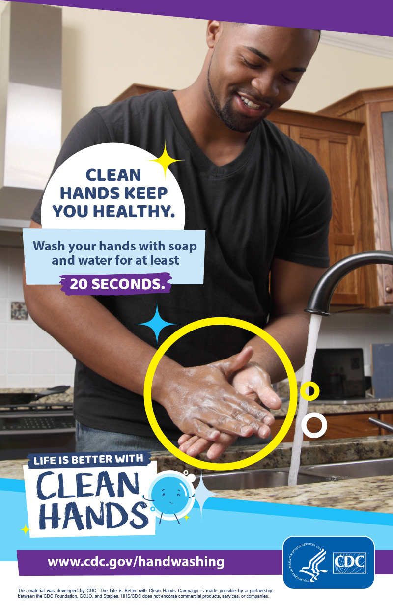 Close-up of a man washing his hands in a kitchen and a reminder to make handwashing a healthy habit.