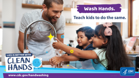 A man washing his hands with children in a kitchen and a reminder to teach kids to do the same.
