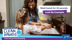 Close-up of a mother helping her daughter wash her hands and a reminder to lead by example when teaching handwashing.