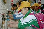global handwashing day - children washing their hands at a school in china