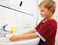 a little boy washing his hands