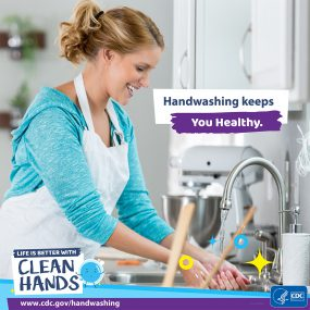 Close-up of a woman washing his hands in a kitchen and a reminder to make handwashing a healthy habit.