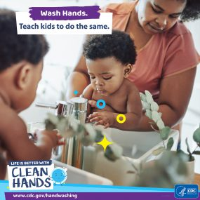 Close-up of a mother teaching her infant wash her hands and a reminder to teach kids handwashing habits.