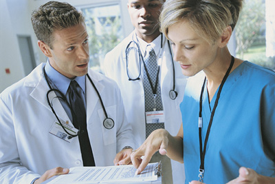 Physicians reviewing paperwork