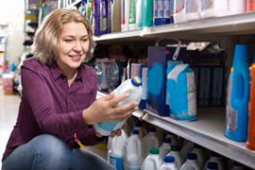 women looking at household cleaning products