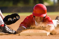 photo: baseball player sliding into base