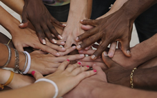 Diverse hands in stacked on each other for unity