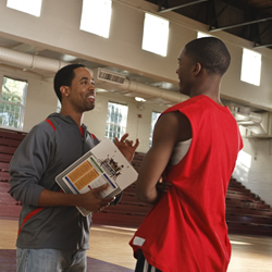 photo: coach talking to basketball player