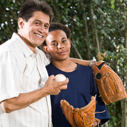 Father and teenage son with a baseball glove and ball