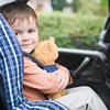 Boy in a car seat with a teddy bear