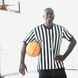 referee holding basketball