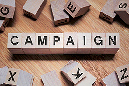 Scrabble letters spelling out the word Campaign representing Featured Campaigns.