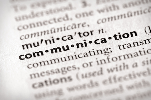 A close-up dictionary photo of the word communication.