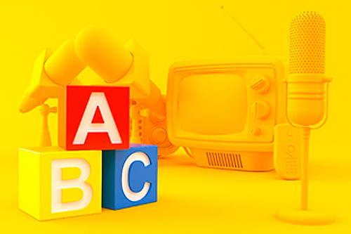 Bright yellow background with  red, yellow, and blue ABC blocks and tv in the background representing basics.