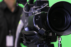 Close-up of a Television camera and camera man filming a Television scene