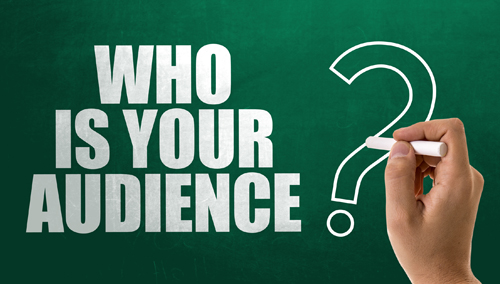 Large white letters written on a green chalk board that say Who is your audience?