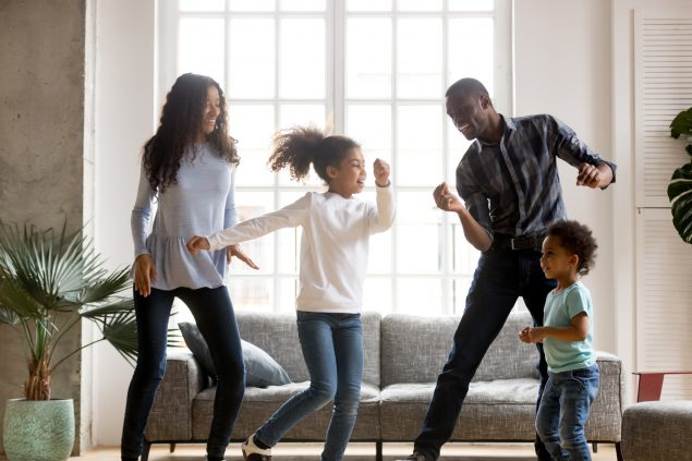 Happy African Americans having fun together indoors