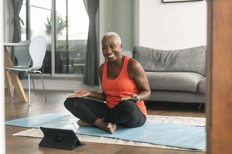 woman sitting on floor exercising