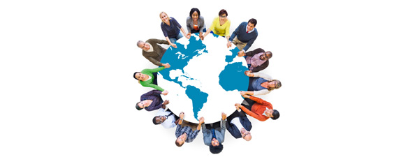 Large group of people holding hand around globe of earth