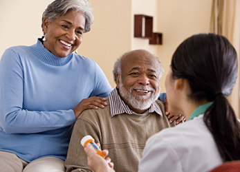 Older adults being counseled by a health professional.
