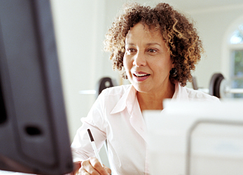 Woman learning in front of computer
